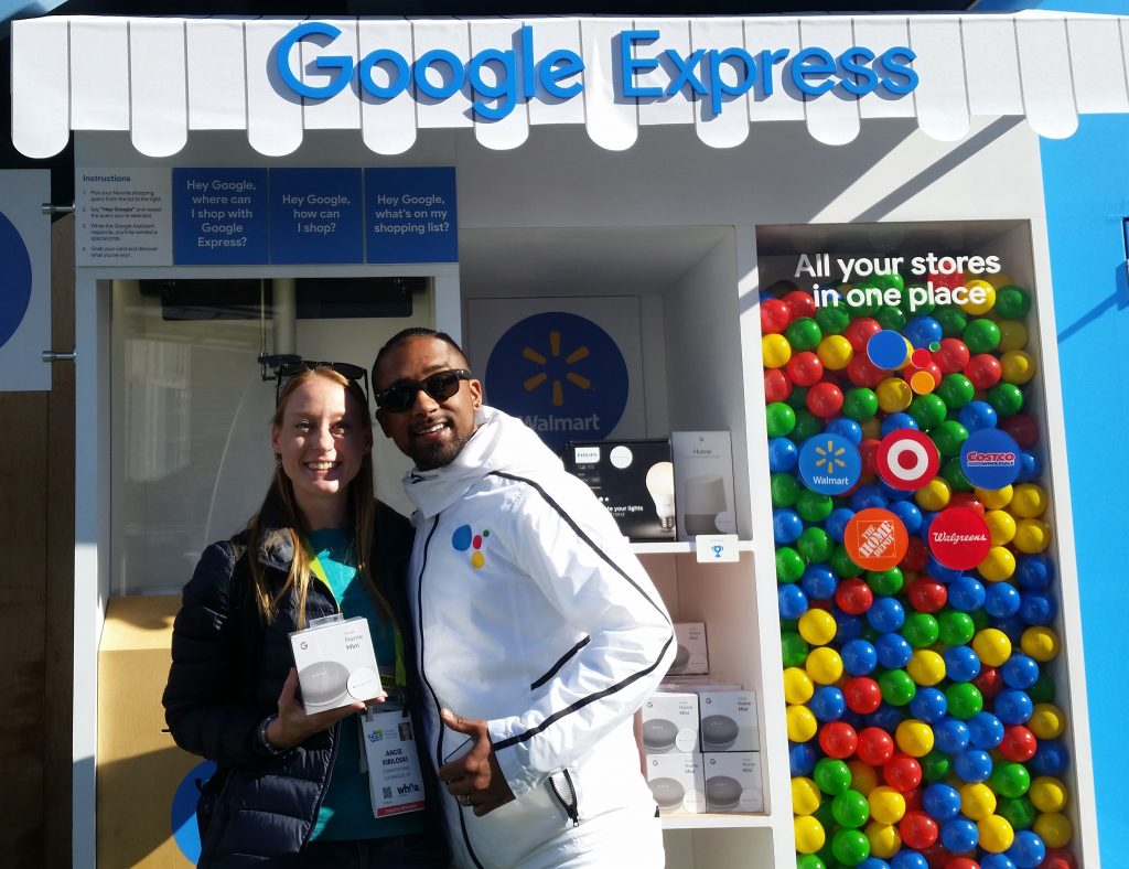Image of Angie Kibiloski Winning Google Home Mini at Google Express Booth