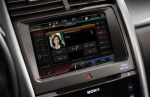Image of 8-inch touch screen, divided into 4 main areas to control Climate, Audio, Phone, and Navigation